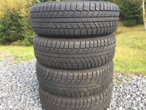 Four 205/70R15 Winter Tires - Like New