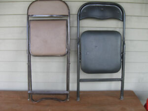 TWO STURDY METAL FOLDING CHAIRS  [ONE BLACK / ONE BROWN]