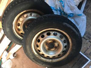 Two 14inch Honda rims with winter tires (lots of life)