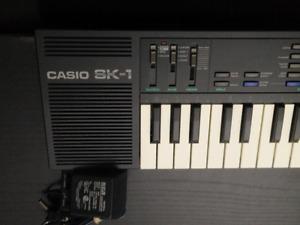 Casio SK-1 , Sampling  Keyboard, with adapter .