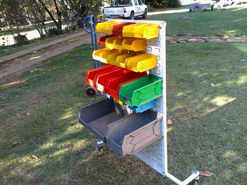 Storage stand with plastic bins