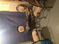 Like new wrought iron and glass dining set