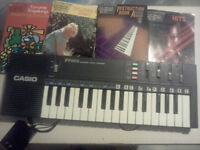 Casio keyboard (small), comes with learners books