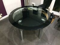 Round glass dining room table with shelf