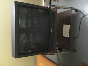 "27"" Sears TV. Exc. condition & stand on wheels"