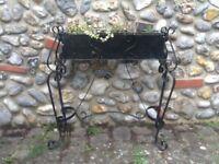 Black wrought iron planter