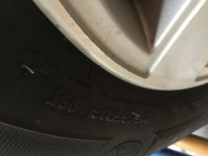 4 Original rims with tires from a Toyota Sienna