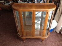 Wood and glass bow fronted display cabinet