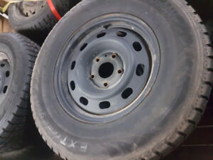265-70-17 DODGE RAM RIMS WITH WINTER STUDDED TIRES