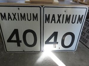 Two METAL 40 KM DRIVING SIGNS BOTH ONE PRICE asking $55 or best