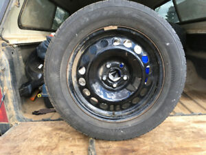 Chevy Curz 215/60R 16 Steel rims and tires 10% tread