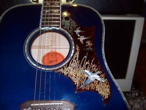 blue gibson dove in flight electric acoustic guitar