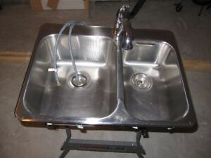 Kitchen sink with facet