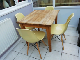 Oak dining table and four Eames style Eiffel chairs