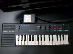 Casio SK-10 Sampling Synthesizer Keyboard with power adapter.