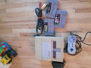 Super nintendo with three games and one controller.