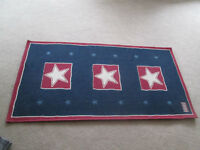 Area rug, with navy blue background,