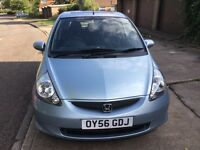 A 2006 Honda Jazz, blue ,1.4 petrol manual with 6 month Mot