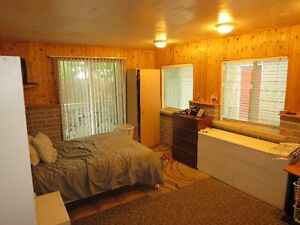 A spacious room is available for rent in a house in Gatineau