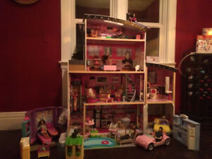 Fantastic Barbie house with lots of dolls & accessories!