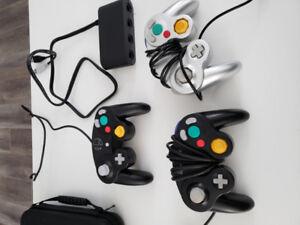 2 manettes de gamecube original + 1 pas original, avec adapter