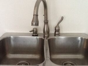 Kitchen sink,faucet and soap dispenser