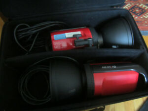 Two Orion 200 with Stands, Umbrellas, Cords, and Cases