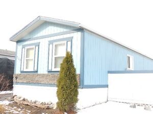 Mobile with addition, owned lot in Hinton, Alberta
