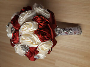 Off-white and red, jewel-encrusted bridal bouquet