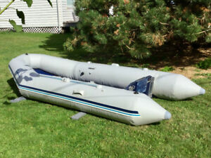 Zodiac Typhon 335 Inflatable with 15 hp Johnston Outboard