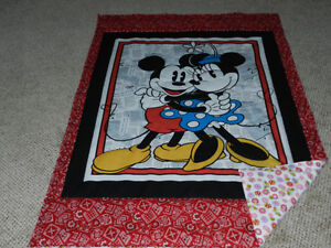 a New Mickey & Minnie quilt to fit a toddler bed.