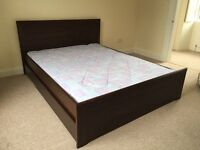 King size dark wood IKEA bed with mattress and drawers