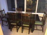 Dark solid wood dining table & 8 turned spindle chairs