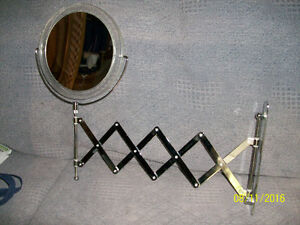 Wall mounted expanding mirror