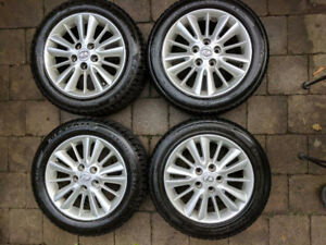 LIGHTLY USED Set of winter tires and alum.rims with Lexus cover