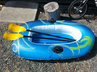 Inflatable boat, floating chairs and boogie boards