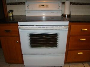 Stove,General Electric ceramic top self clean white in color