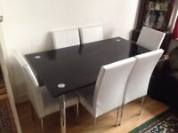 Heavy duty Glass table and 6 Chairs