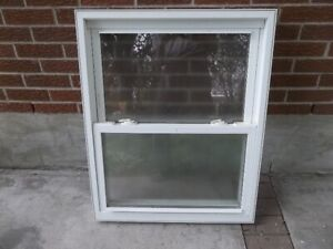 Used and good condition Vinyl and Aluminum windows /Door inserts