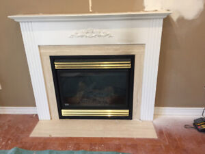 Classic white fireplace mantel with molding  and 3 beige stones