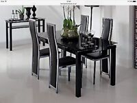 Noir extending dining table and four chairs brand new still in the box