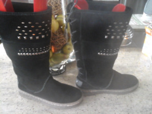 Black suede Bearpaw boots with sheepskin interior