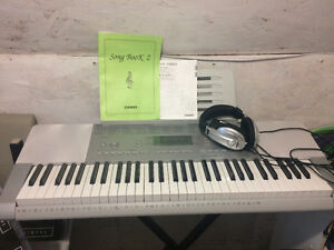 Casio. Self teaching keyboard.  Stand, headphones and bench