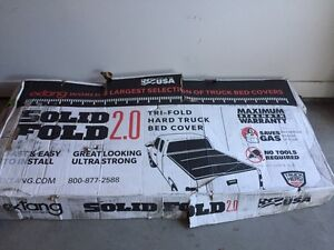 Trifold Hard truck bed cover for a Toyota Tundra 5.5 Ft bed