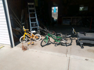 3 Kids bikes and second seat bike trailer