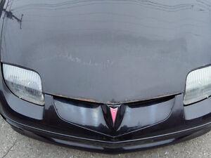 Hello  2001 Pontiac Sunfire a vendre pour pieces ou reparer!!