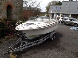 Stunning Draco Topaz power boat 2 berth trailer and engine