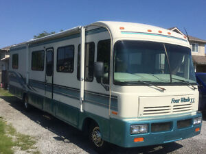 UPDATED LOW MILAGE 34 FOOT CLASS A MOTOR HOME