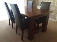 Solid wood dining table & chairs very good condition