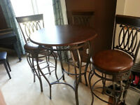 Excellent quality metal pub table and three chairs